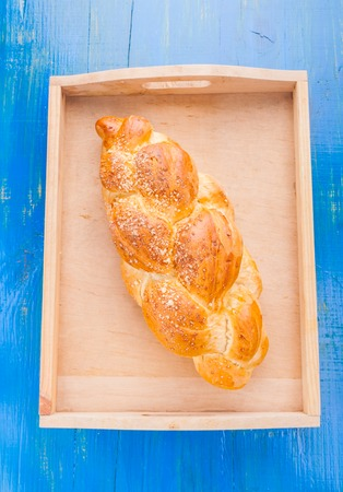 challah: challah on the blue wooden table. studio shot Stock Photo