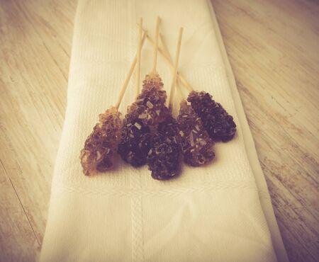 Crystal brown rock sugar candy on a stick. studio shot photo