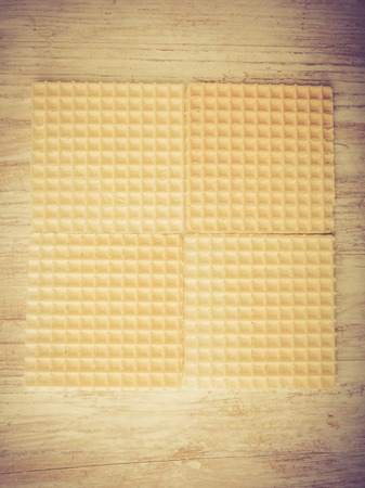 lomography: Dry wafers on white wooden table. studio shot