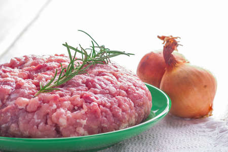 sprig: pork minced meat with a sprig of rosemary. studio shot Stock Photo