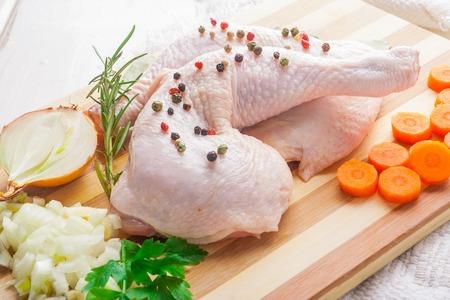 animal leg: Fresh raw chicken legs on a wooden table. studio shot Stock Photo