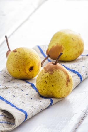 fres: Fres hyellow  pears on the cloth. studio shot