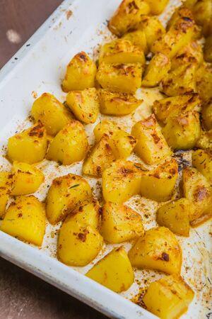 roast potatoes: Roast potatoes with herbs on a white plate. studio shot