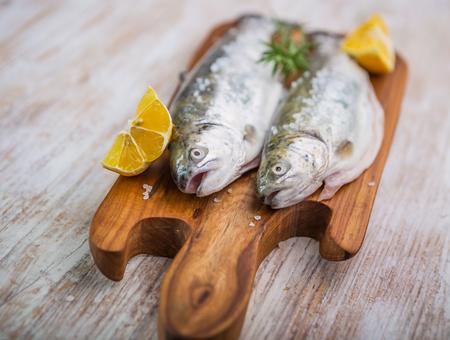 Fresh fish trout on the kitchen board. studio shot photo