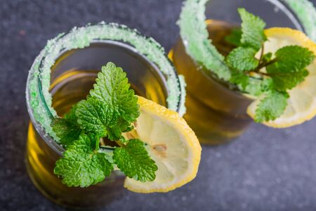 drink tea: Herbal Tea with a fresh lemon balm leaves on a black table