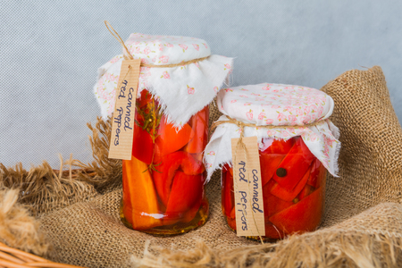 paprica: Delicious sweet red pepper pickles in jar. studo shot Stock Photo