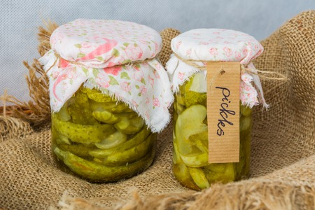 storeroom: Pickles in a jar on the tablecloth. studio shot