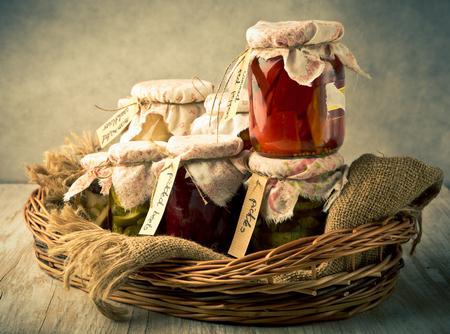 Vintage photo of homemade preserved vegetables in jars. studio shot