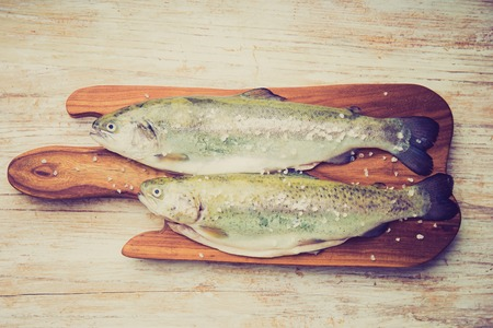 lomography: Vintage photo of two rainbow trouts on a cutting board