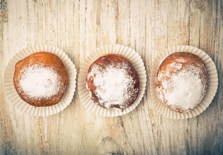 lomography: Vintage photo of homemade donuts on white table Stock Photo