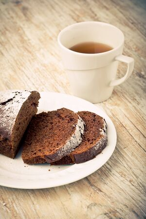 gingerbread cake: Vintage photo of soft homemade gingerbread cake and cup of tea