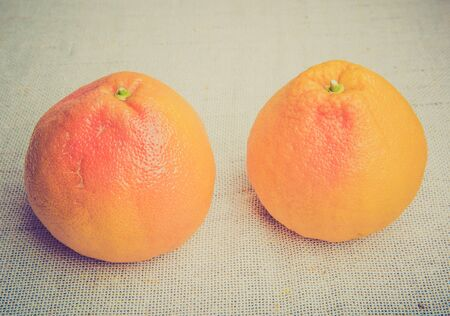 lomography: Vintage photo of two grapefruits on a white table