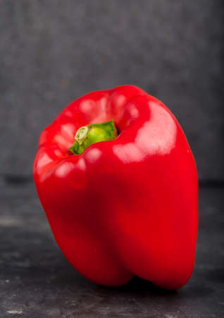 bell peper: red pepper on a black background