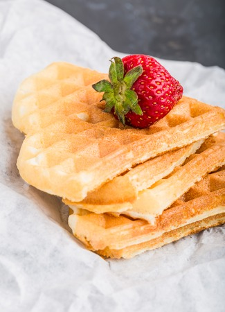 afters: Waffles with strawberry on white paper Stock Photo