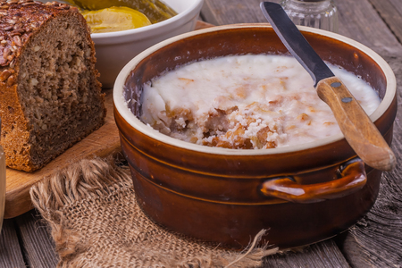 collation: lard with cracklings in bowl on old wooden table