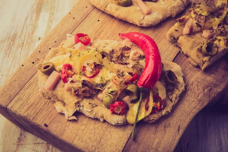 focaccia: Vintage photo of focaccia with olives, peppers and chicken Stock Photo