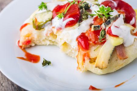 mini pizza: Mini pizza appetizers homemade on thewhite plate Stock Photo