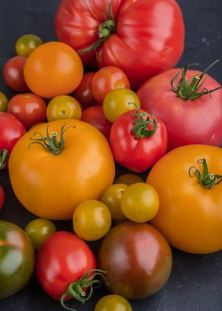 varieties: Assorted varieties of ripe tomato on table. studio shot Stock Photo