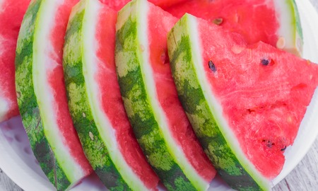 sliced watermelon: pieces of fresh red watermelon next to one another Stock Photo