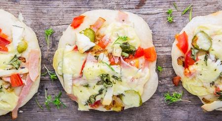 mini pizza: Mini pizza appetizers homemade on the old board