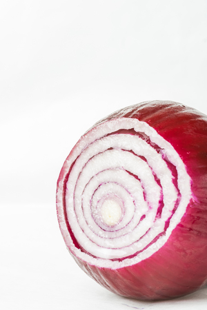 aftertaste: Red onion isolated on white background, studio shot