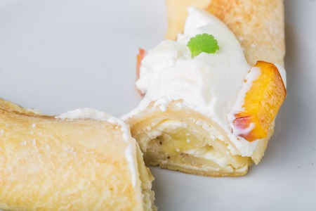 sour cream: Pancak with cottage cheese and peach doused sour cream Stock Photo