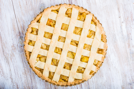 Homemade apple pie with cinnamon and sugar on wooden table Stock Photo