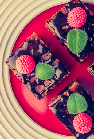 lomography: Vintage photo of chocolate cake with raspberries and fresh mint. Stock Photo