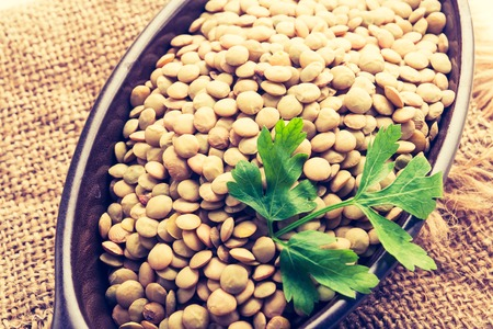 cros: Vintage photo of lentil in a clay bowl