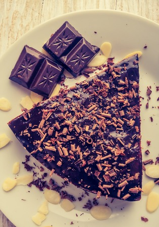 cros: Vintage photo of dark espresso cake with chocolate glaze