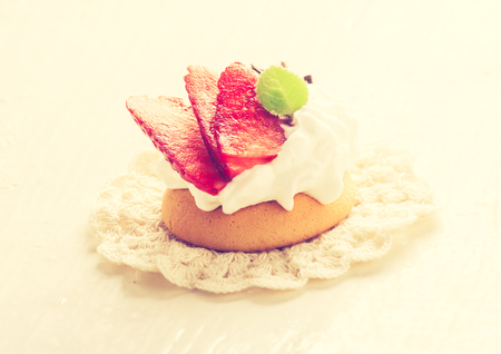 cros: Vintage photo of small biscuits with fruits and whipped cream