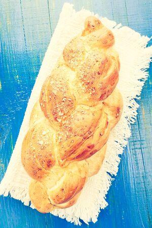 cros: Vintage photo of challah bun on the table