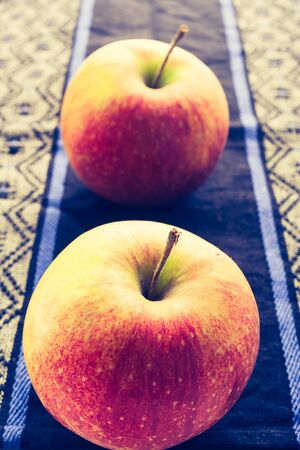 cros: Vintage photo of two apples on the cloth Stock Photo
