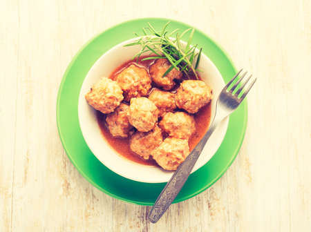 cros: Vintage photo of bowl with meatballs and tomato sauce