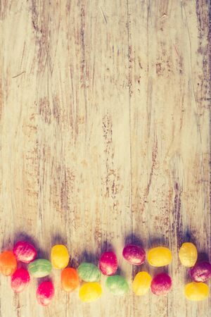 lomography: Vintage photo of colorful candies on wooden table