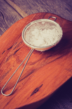 sieve: Vintage photo of powdered sugar in a sieve