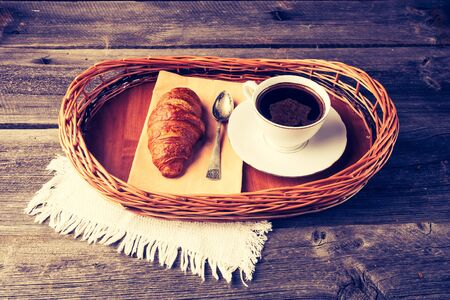 caf: Vintage photo of coffee and croissant. breakfast table Stock Photo