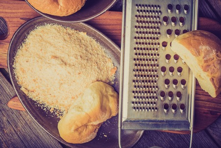 crumbing: Vintage photo of homemade breadcrumbs on a wooden table