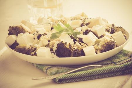 broccoli salad: Vintage photo of broccoli salad with feta cheese and almonds
