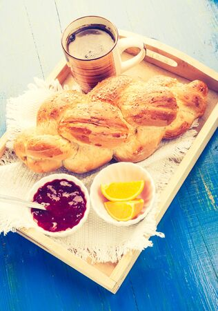 cros: Vintage photo of coffee and challah. breakfast table