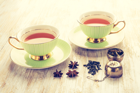 lomography: Vintage photo of green tea in a cup on wooden table