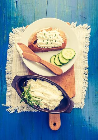 cros: Vintage photo of cottage cheese on a bread, cottage cheese in bowl Stock Photo