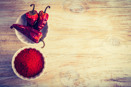 cros: Vintage photo of dry chilli pepper in bowls