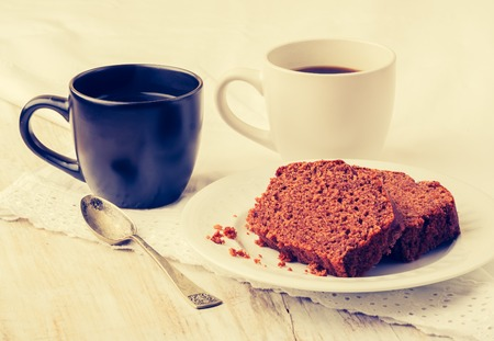 gingerbread cake: Vintage photo of soft homemade gingerbread cake and cups of coffee
