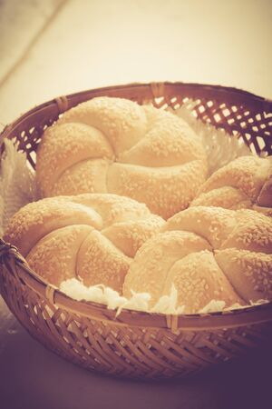 lomography: Vintage photo of buns with sesame in basket