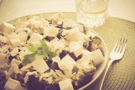 lomography: Vintage photo of broccoli salad with feta cheese and almonds
