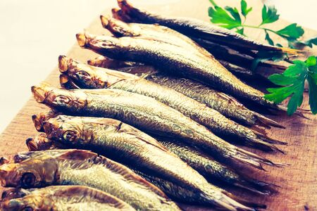 lomography: Vintage photo of smoked sprats on cutting board