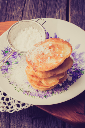 lomography: Vintage photo of pancakes with powdered sugar on plate