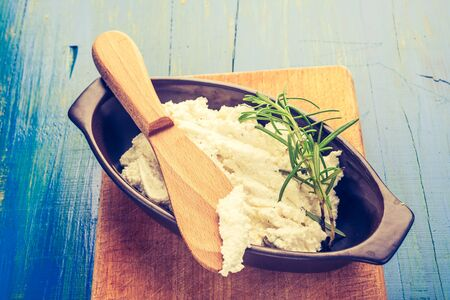 cros: Vintage photo of fresh cottage cheese in a bowl