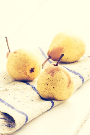 cros: Vintage photo of ripe pears on the cloth